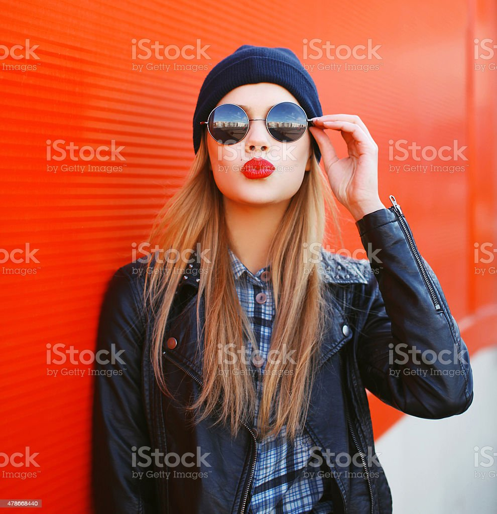 Portrait of fashionable blonde girl with red lipstick wearing a stock photo