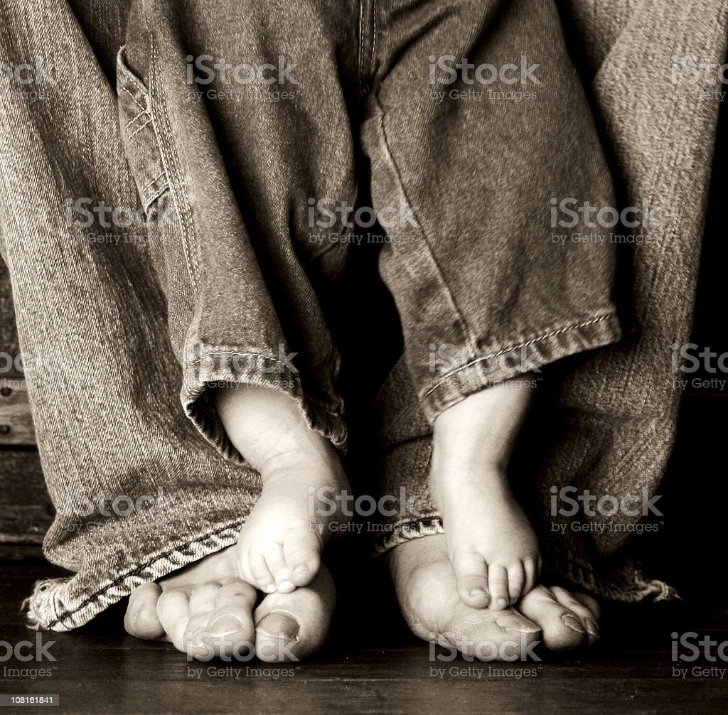 Portrait of Father and Baby's Feet, Sepia Toned royalty-free stock photo