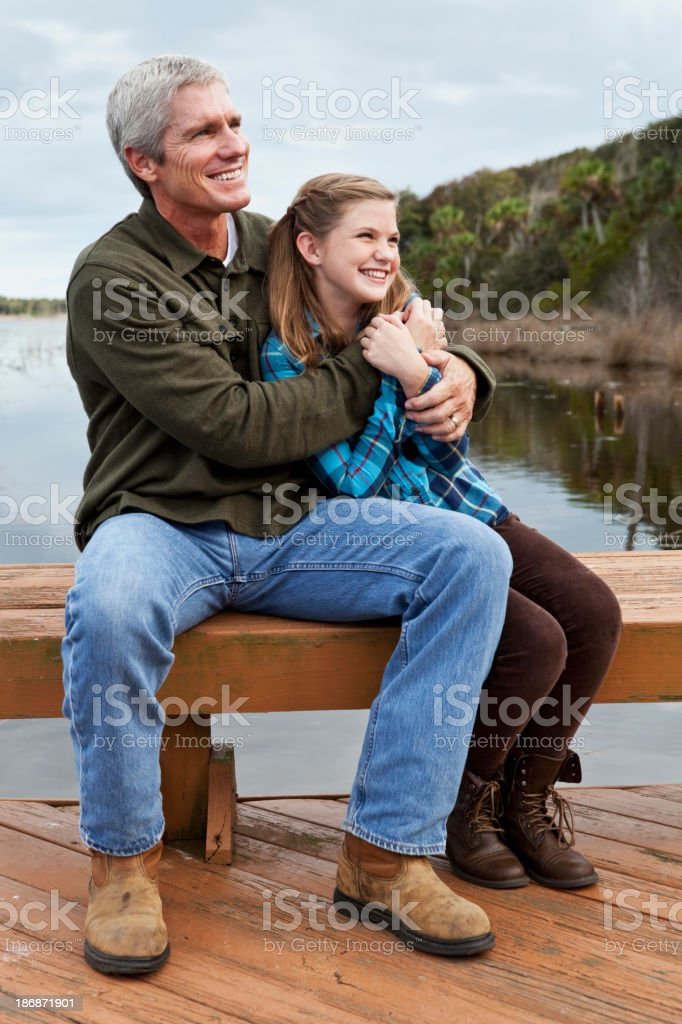 Portrait of father and preteen daughter by water royalty-free stock photo