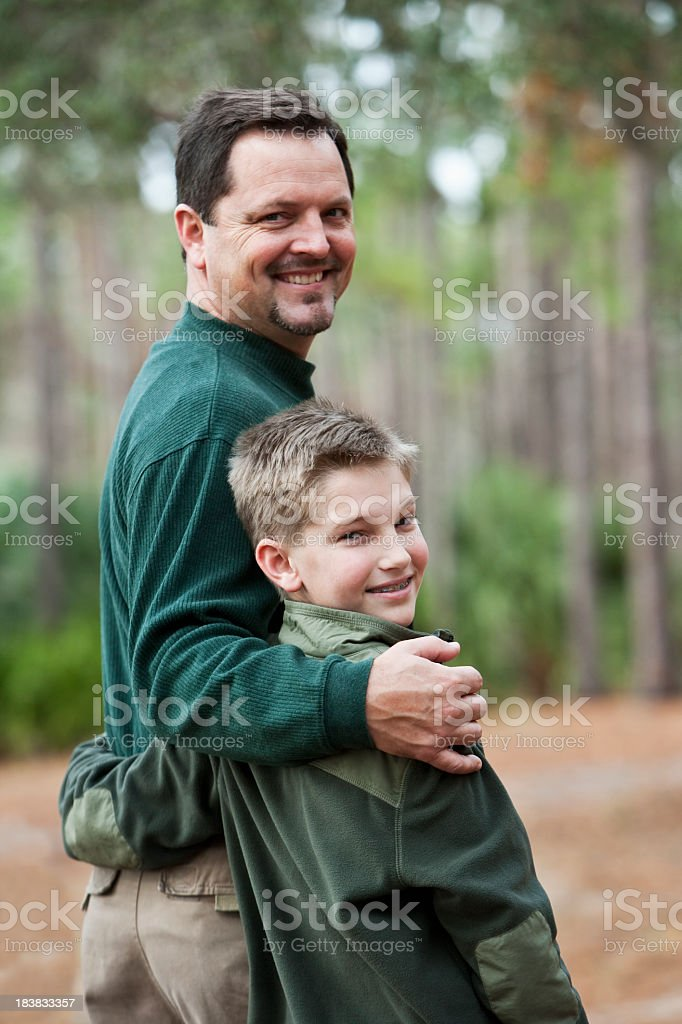 Portrait of father and son at park royalty-free stock photo