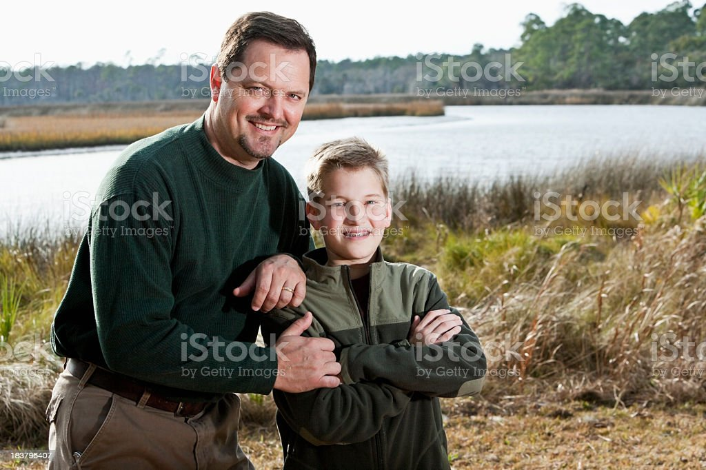 Portrait of father and son enjoying scenic view royalty-free stock photo