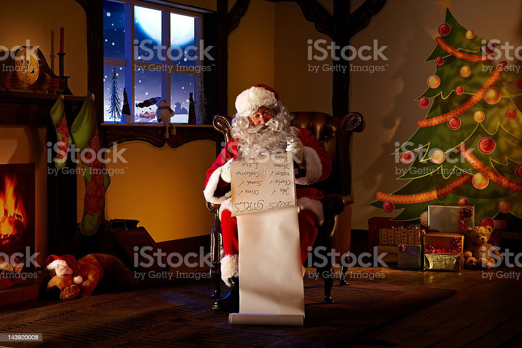 Portrait of Father Christmas checking his list royalty-free stock photo