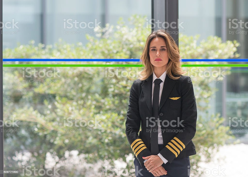Portrait of female airline pilot stock photo