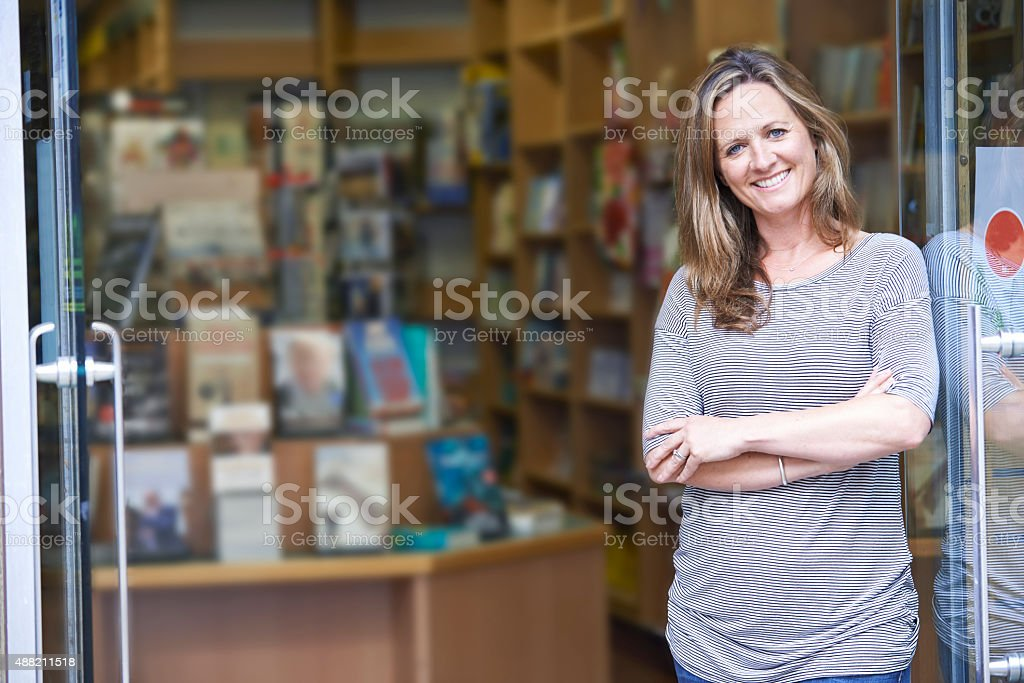 Portrait Of Female Bookshop Owner Outside Store stock photo