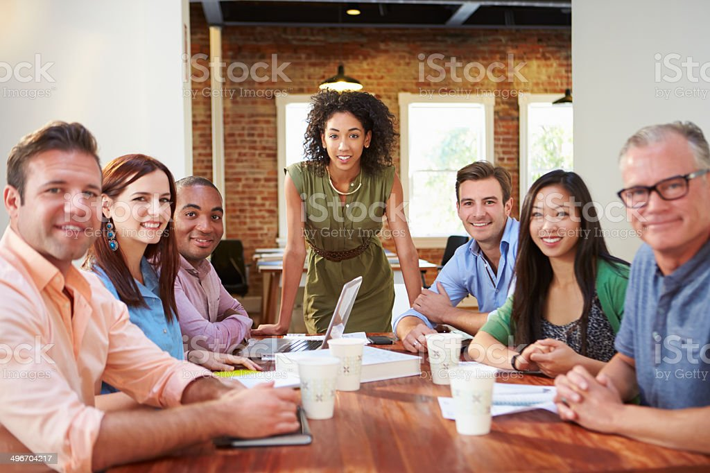 Portrait Of Female Boss With Team In Meeting royalty-free stock photo