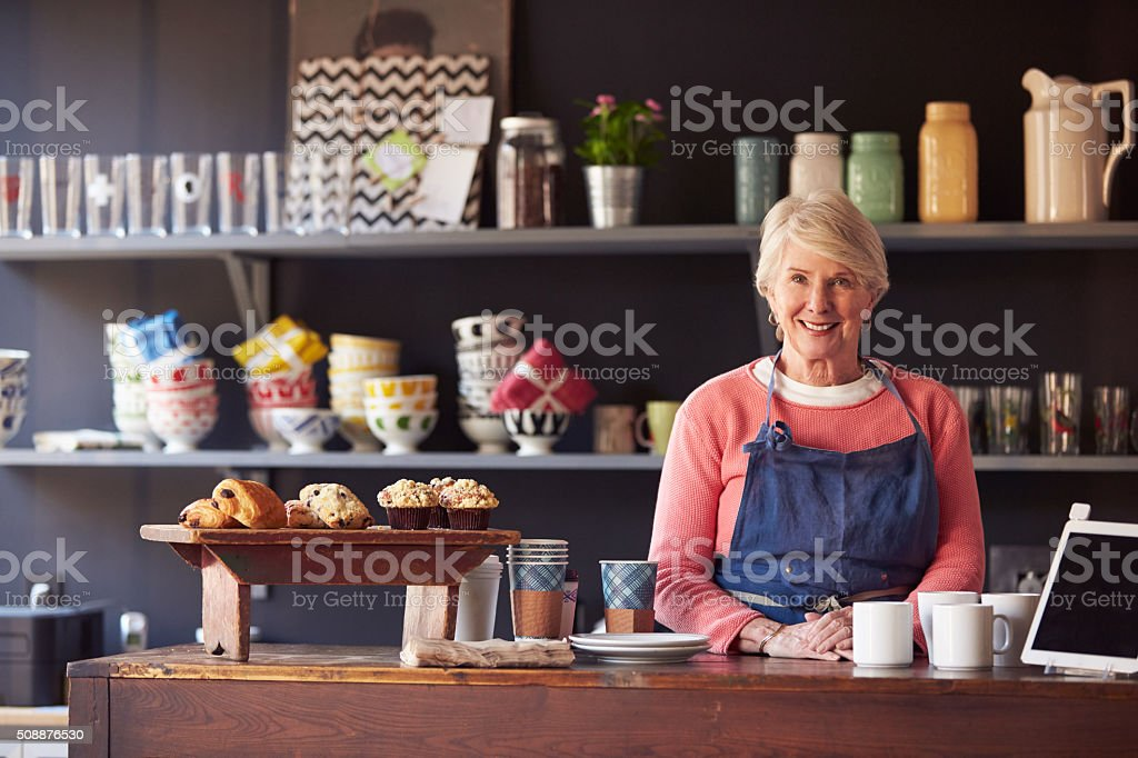 Portrait Of Female Coffee Shop Owner Standing Behind Counter stock photo