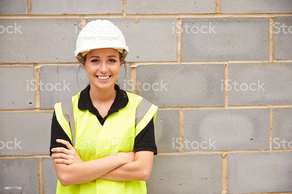 Portrait Of Female Construction Worker On Building Site stock photo