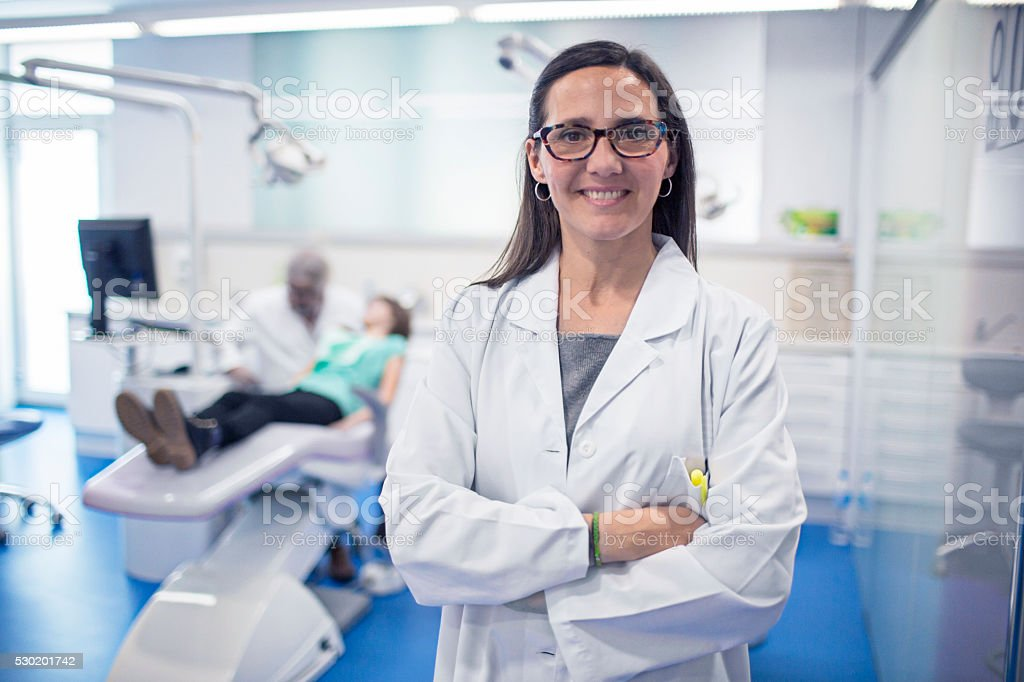 Portrait of female dentist at the dental surgery.