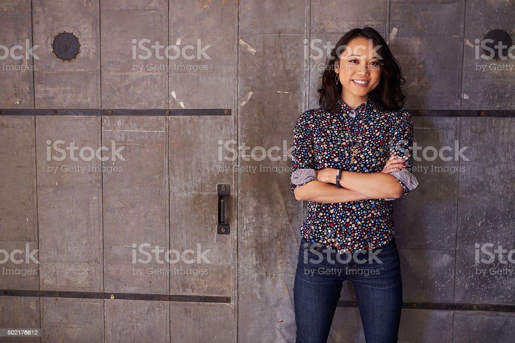 Portrait Of Female Designer Standing In Modern Office stock photo