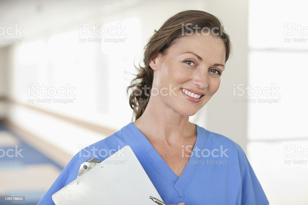 Portrait of female doctor standing in hospital corridor royalty-free stock photo