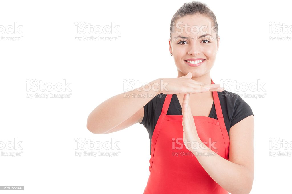 Portrait of female employee doing timeout gesture stock photo