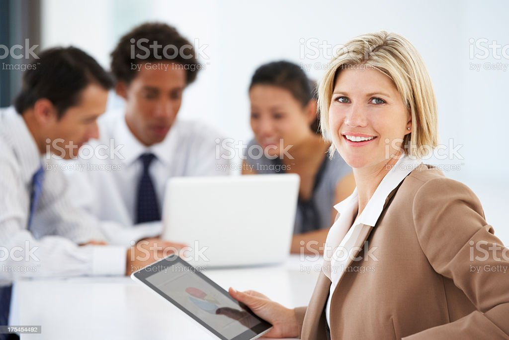Portrait Of Female Executive Using Tablet Computer royalty-free stock photo