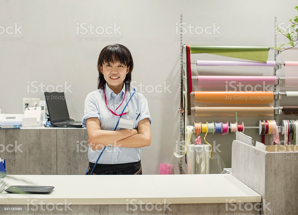 Portrait Of Female Florist in flower shop stock photo