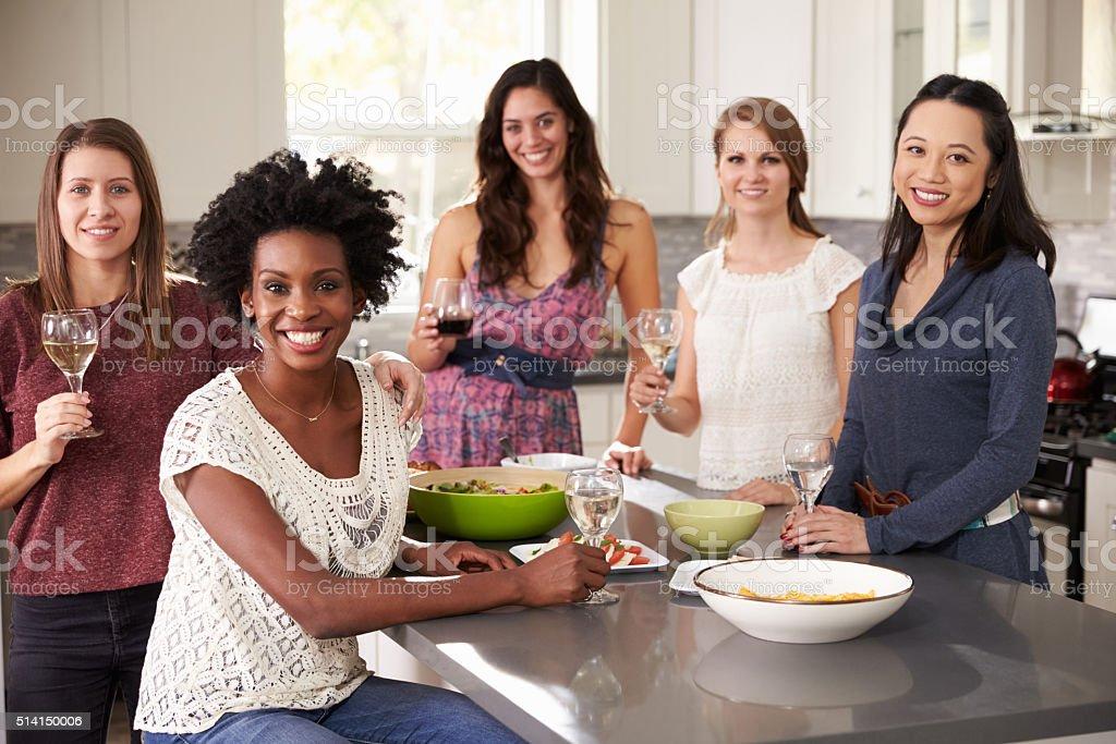 Portrait Of Female Friends Enjoying Pre Dinner Drinks stock photo