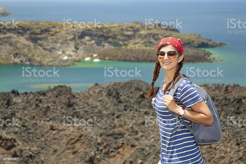 Portrait of female hiker on walk in volcano crater. royalty-free stock photo