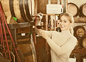 Portrait of  female  holding wine glass in winery