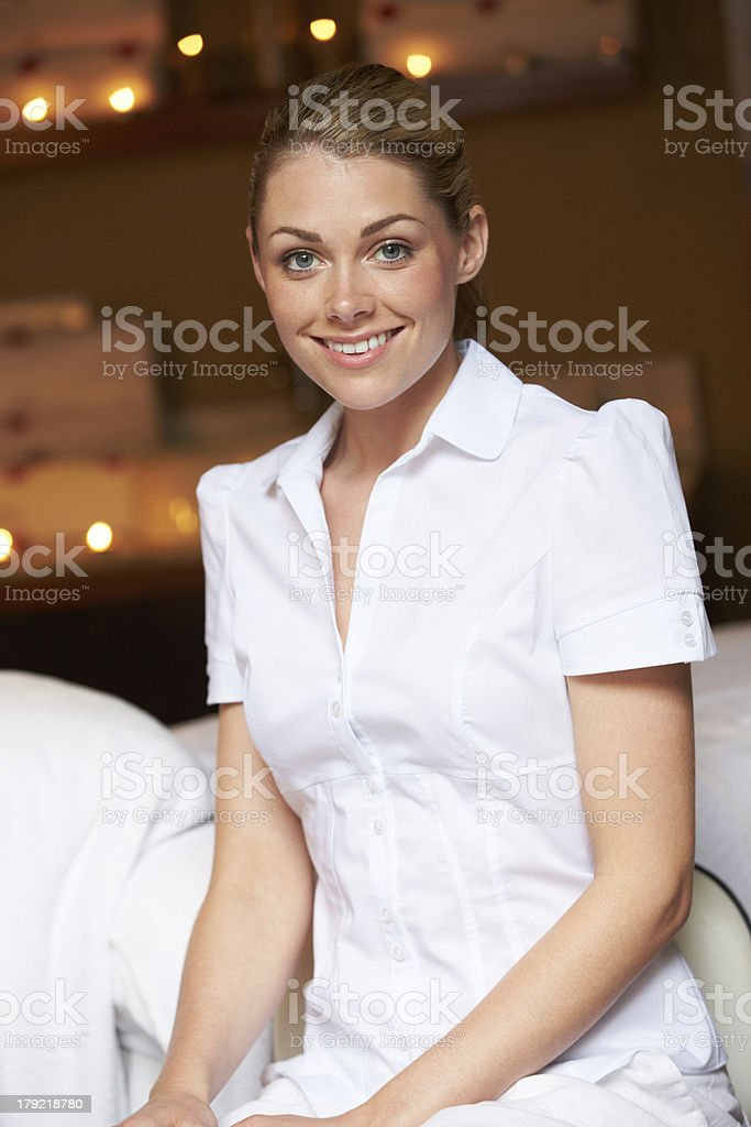 Portrait Of Female Masseuse At Health Spa royalty-free stock photo