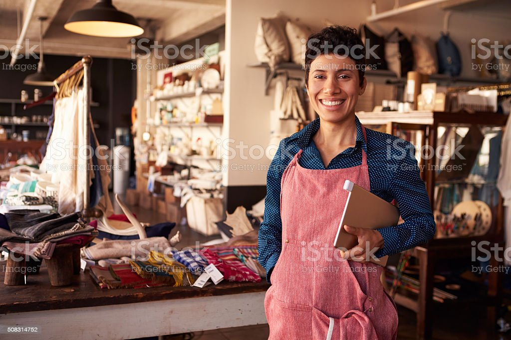 Portrait Of Female Owner Of Gift Store With Digital Tablet stock photo