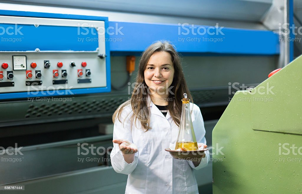 Portrait of female posing with olive oil containers stock photo