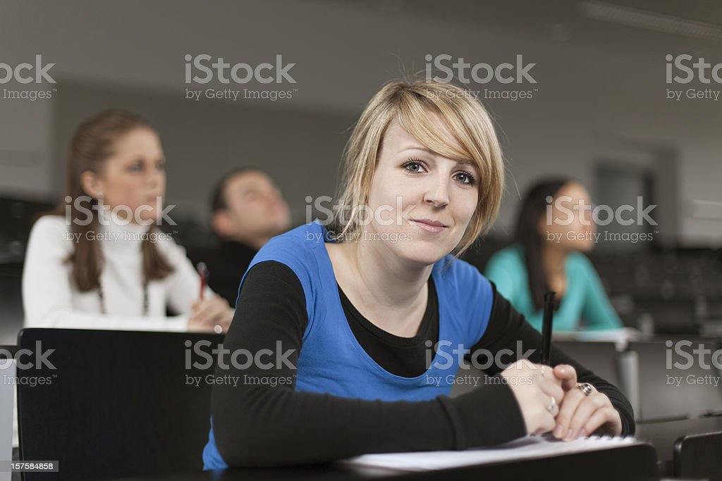 Portrait of female student in lecture hall royalty-free stock photo
