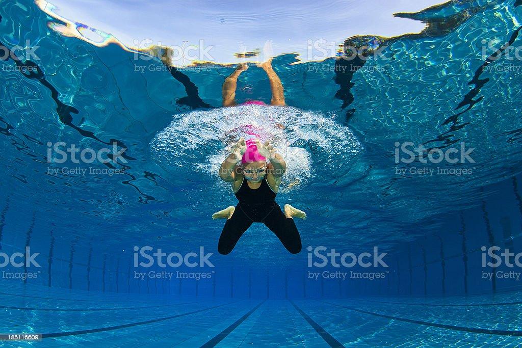 Portrait of female swimmer at breaststroke stock photo