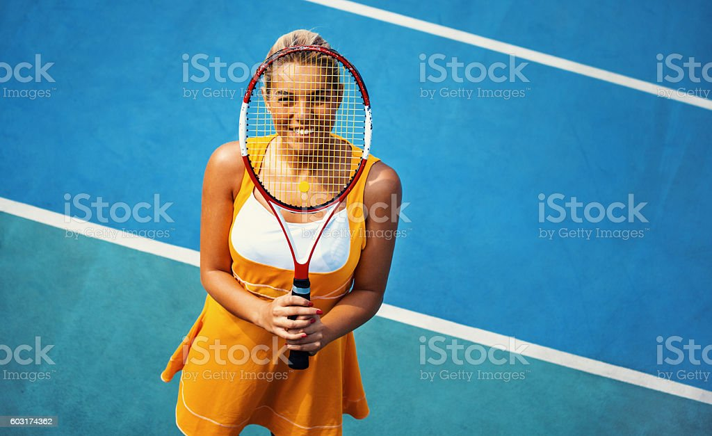 Portrait of female tennis player. stock photo