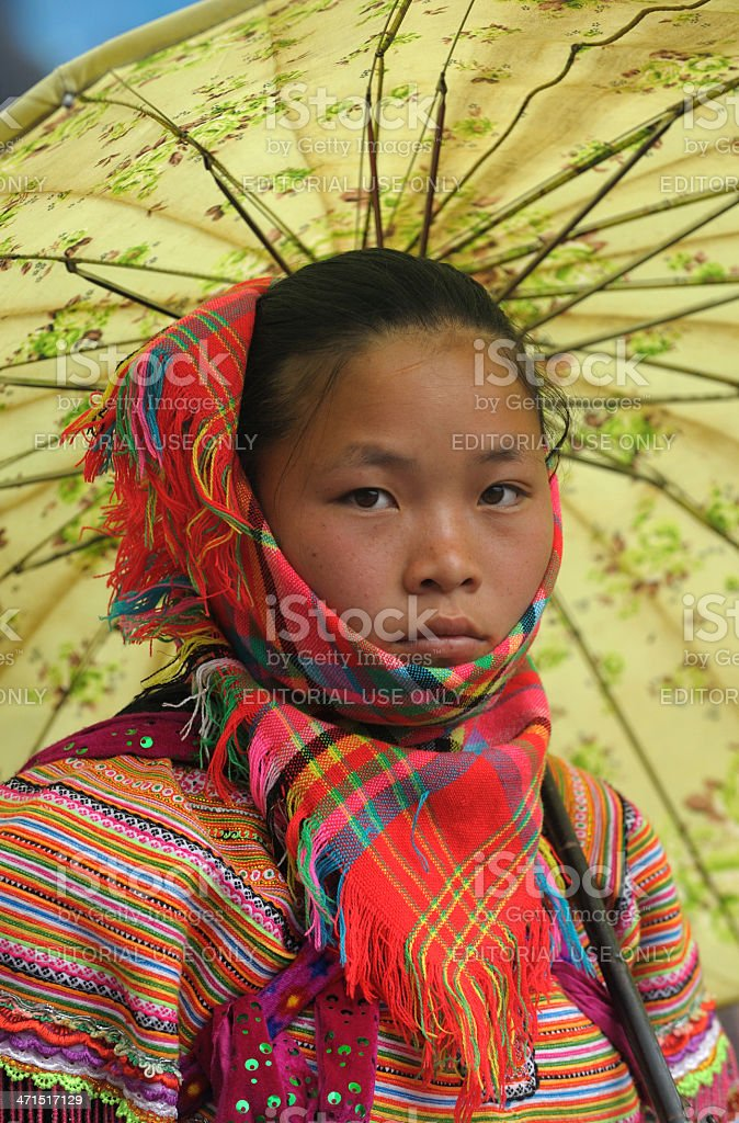 Portrait of Flower Hmong tribe lady with umbrella, Vietnam stock photo
