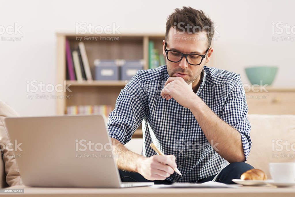 Portrait of focus man working at home stock photo