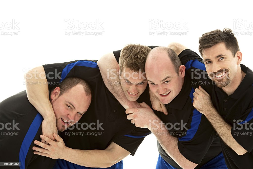 Portrait Of Football Players Having A Playful Fight stock photo