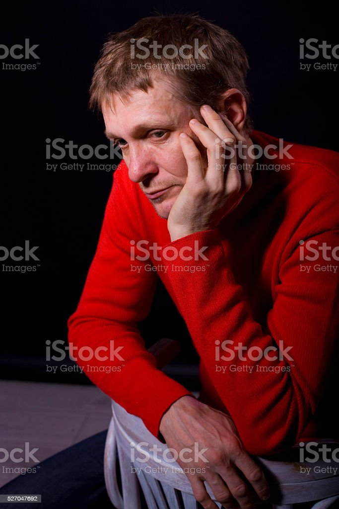 portrait of forty-year-old man on a black background stock photo
