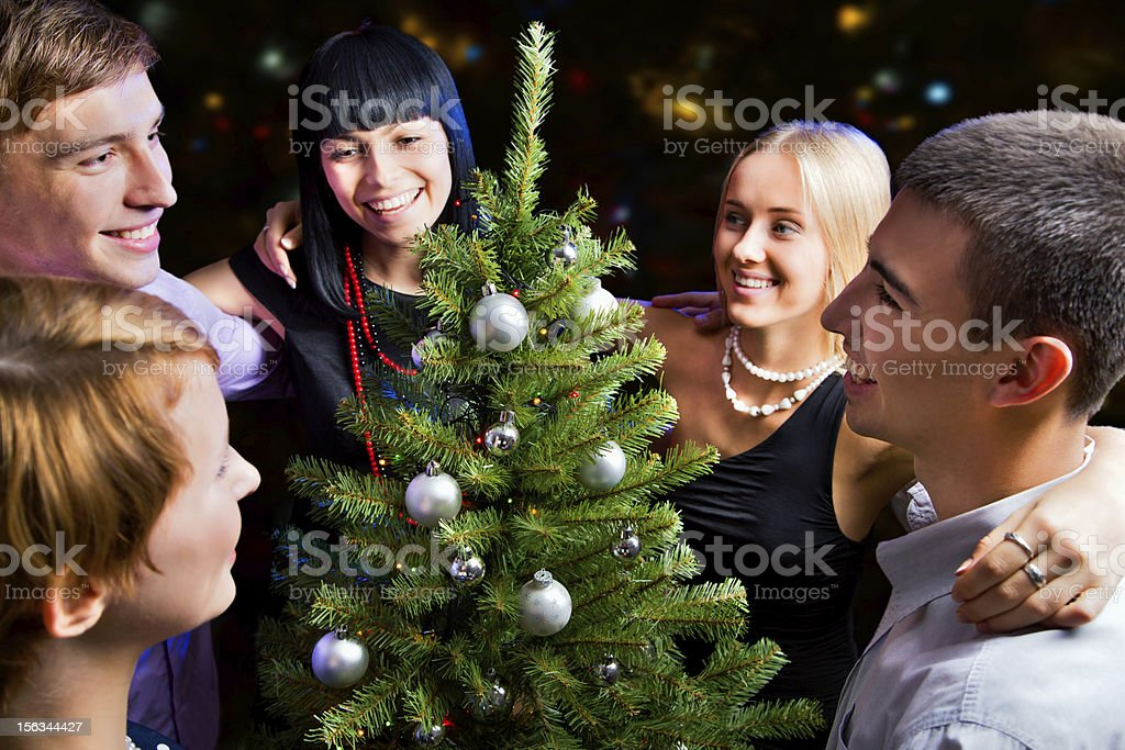 Portrait of friends celebrating New Year royalty-free stock photo