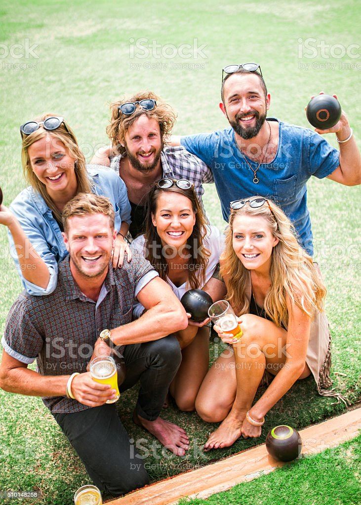 Portrait of Friends Enjoying Lawn Bowling Game stock photo