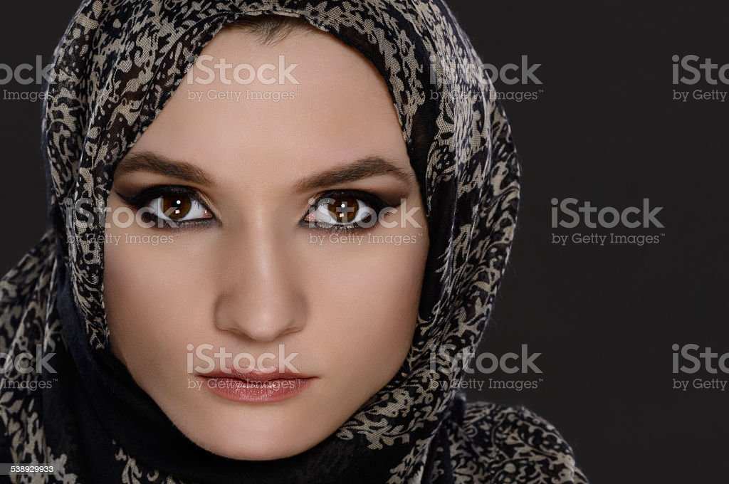 Portrait of front view of a beautiful arab woman face stock photo
