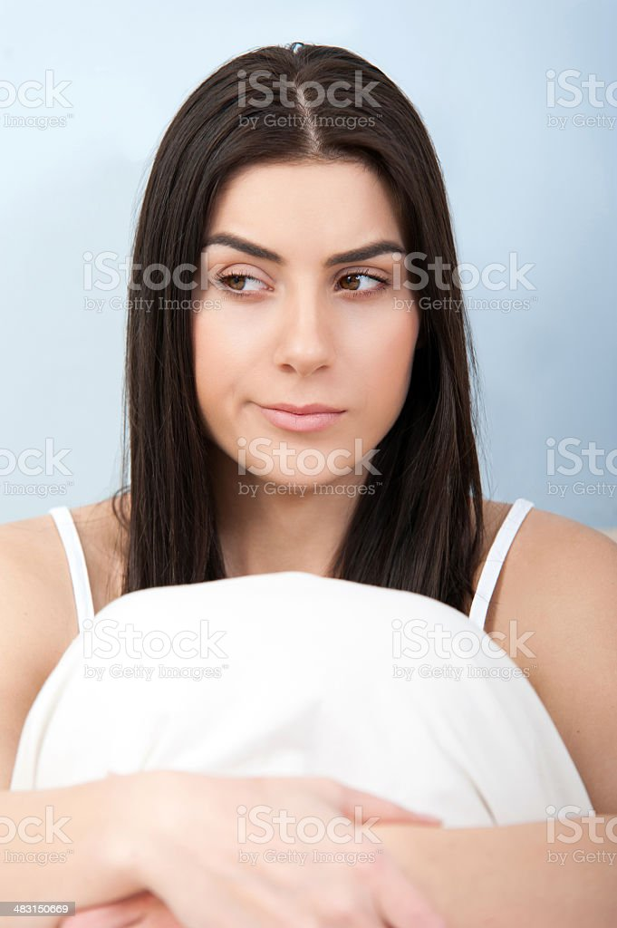 Portrait of frowning young woman stock photo