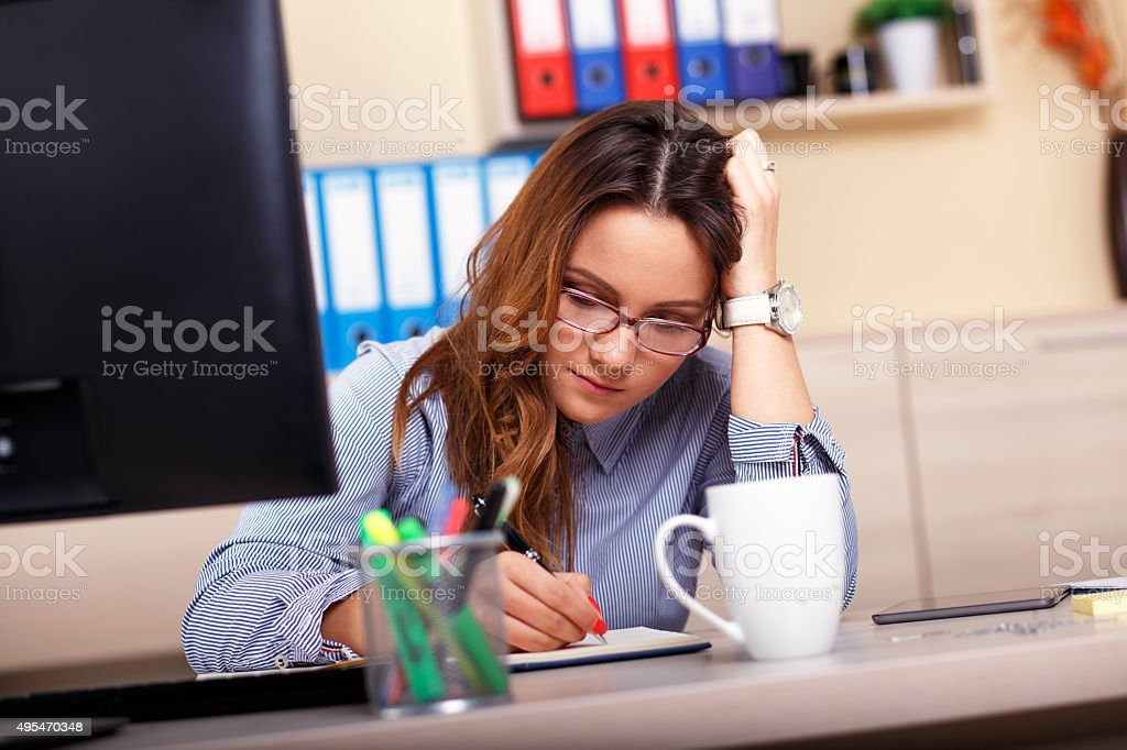Portrait of frustrated businesswoman in the office stock photo