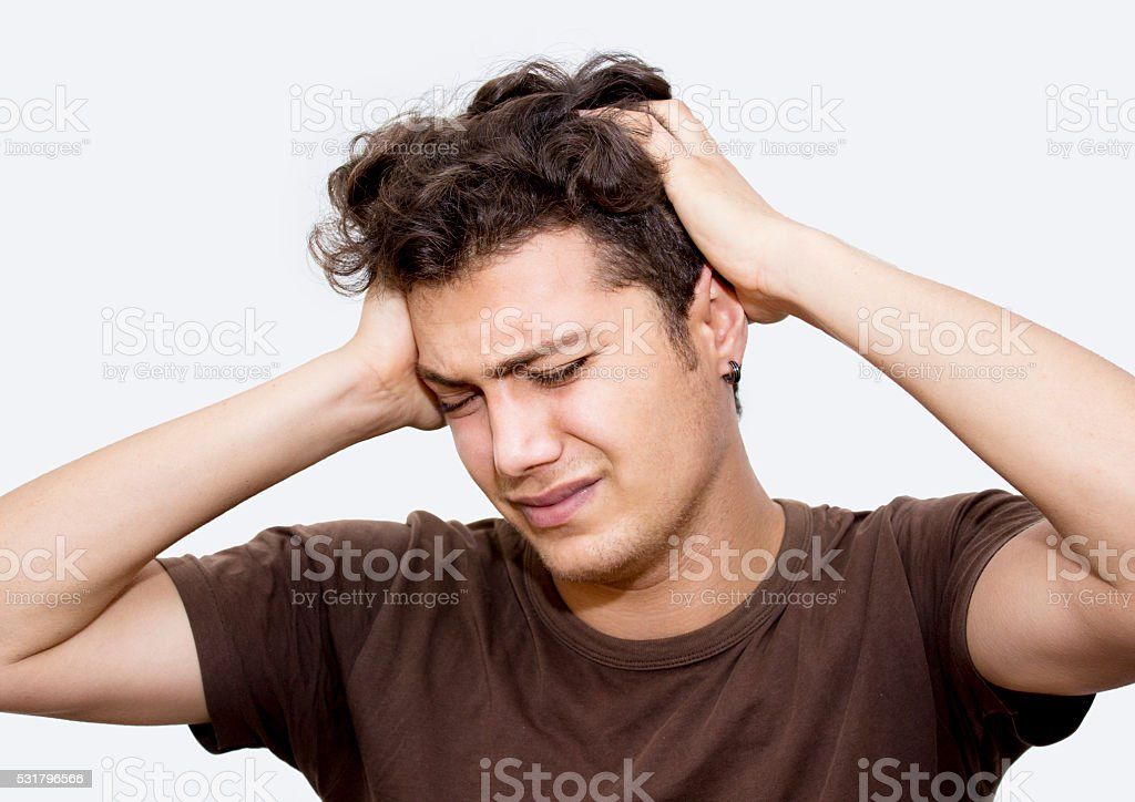 Portrait of frustrated young man over white background stock photo
