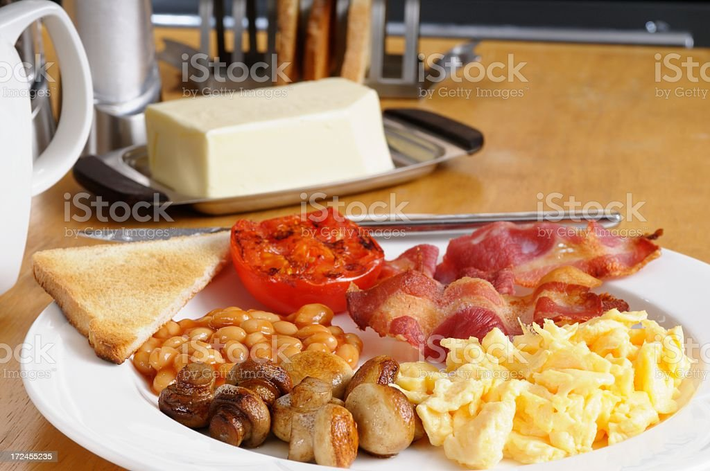 Portrait Of Full English Breakfast Laid Out In The Kitchen stock photo