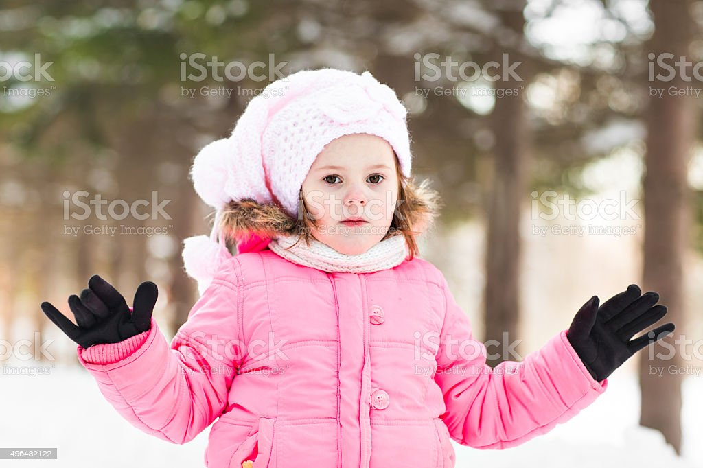 Portrait of funny child in winter park stock photo