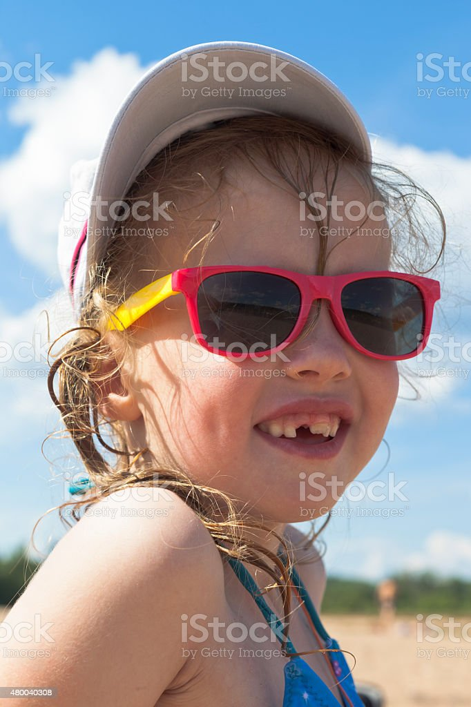 Portrait of funny girl on the beach stock photo