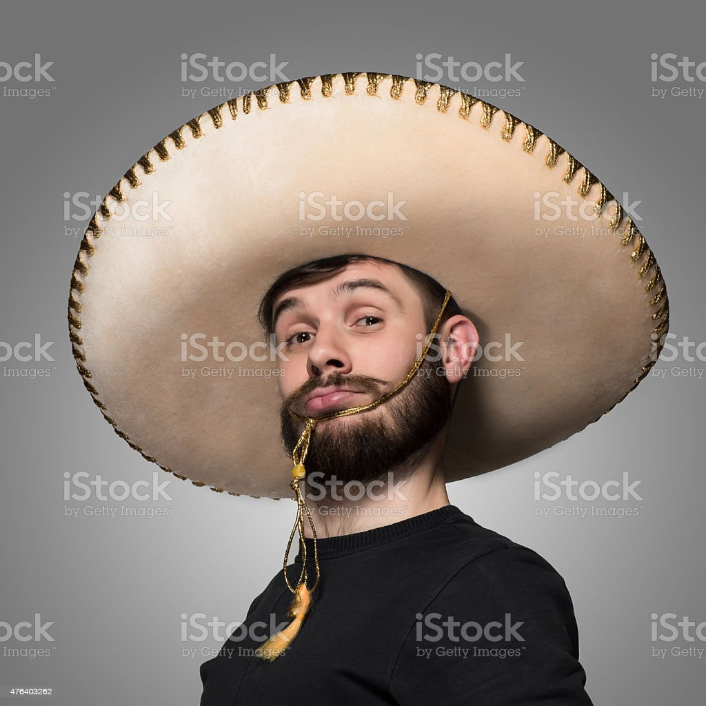 portrait of funny man in Mexican sombrero stock photo