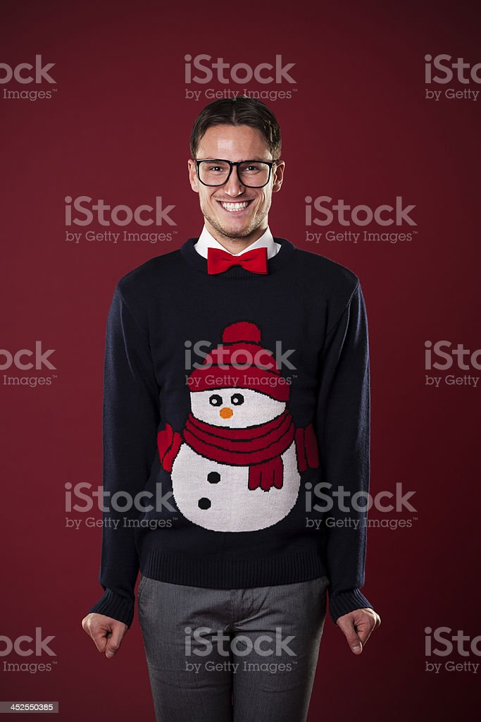 Portrait of funny man wearing sweater with snowman stock photo