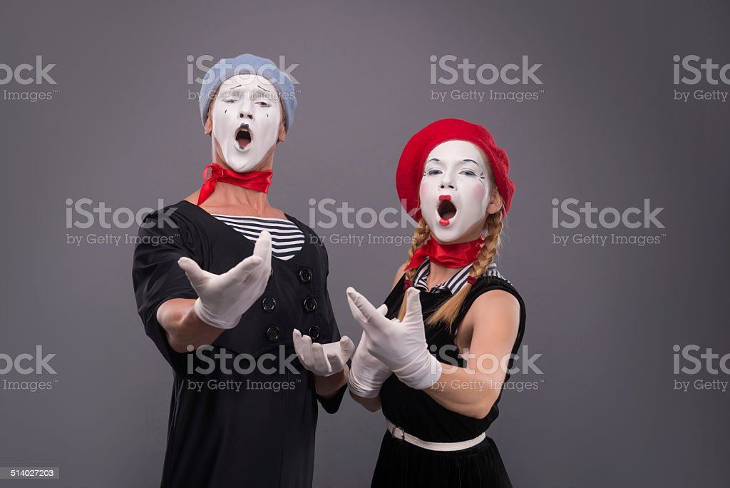 Portrait of funny mime couple with white faces and emotions stock photo