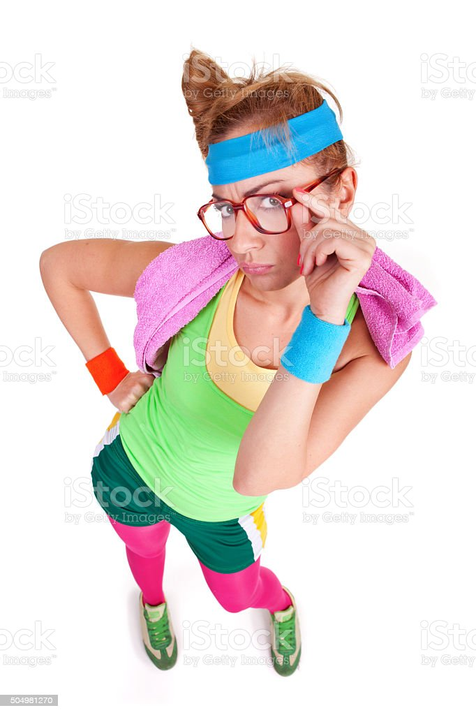 Portrait of funny nerdy fitness girl with glasses looking up stock photo