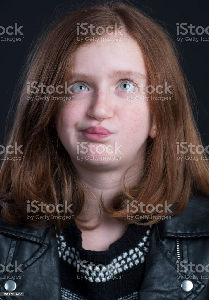 portrait of funny red hair teenage girl stock photo
