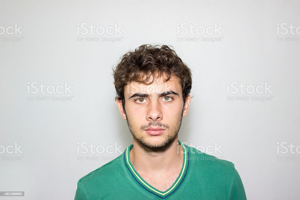 Portrait of furious young man against gray background stock photo