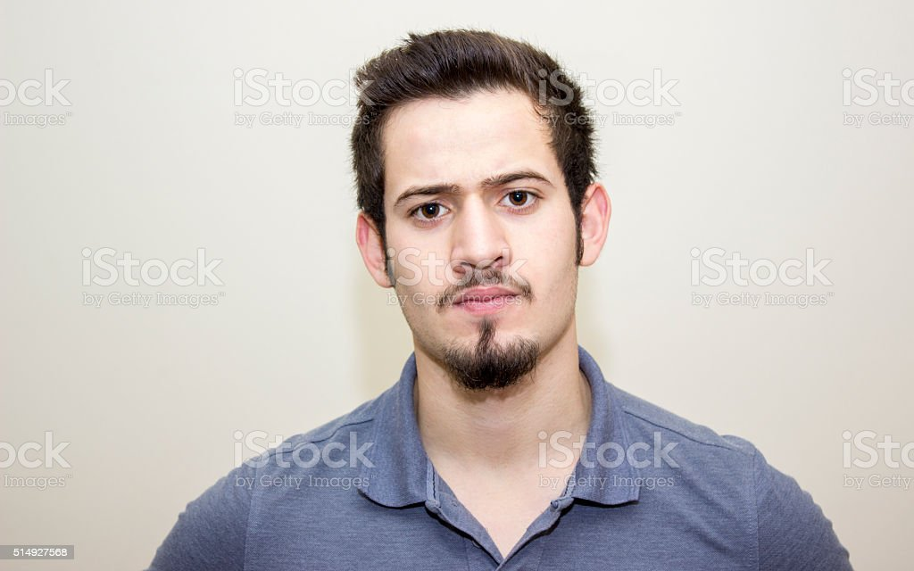 Portrait of furious young man over colored background stock photo