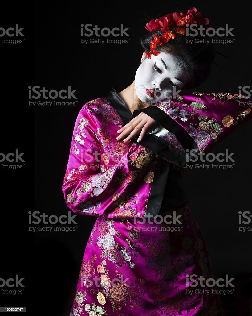 Portrait of geisha dancing isolated on black stock photo