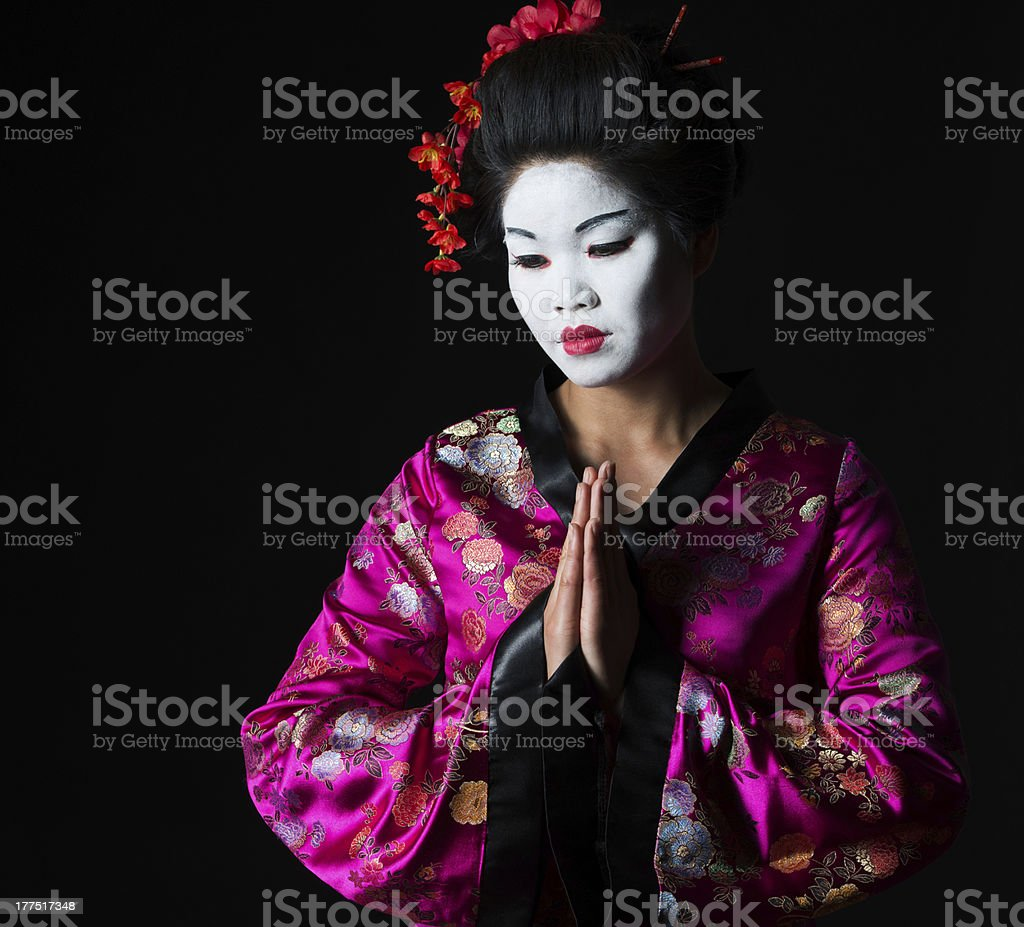 Portrait of geisha with hands together respect gesture stock photo