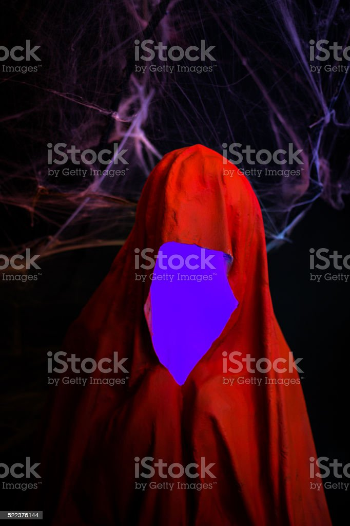 Portrait of ghost covered with red ghost sheet with Cobweb stock photo