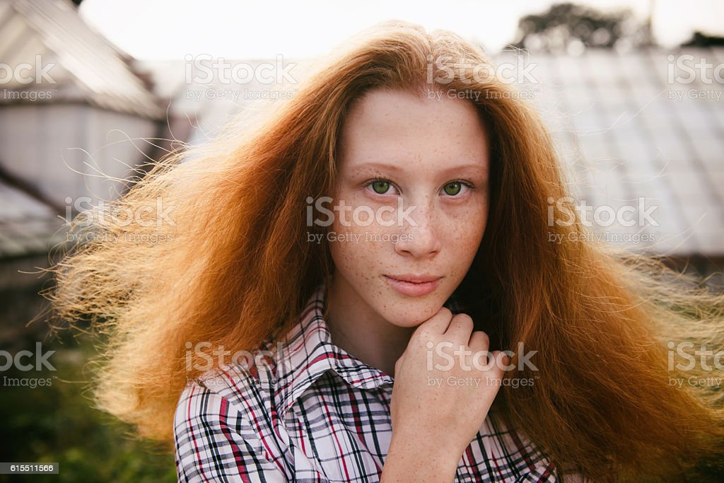 Portrait of ginger haired teenager girl with emotions on face stock photo